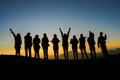Friend groups silhouette in sunrise Stock Photography