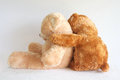 A friend in need teddy bear comforting another teddy Royalty Free Stock Photos
