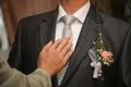 Friend straightens his tie groom the Stock Image