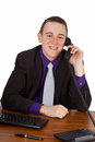 Friendly adviser young businessman on his desk calling up isolated Royalty Free Stock Image