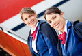 Friendly air hostesses Stock Image