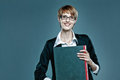 Friendly business woman holding a folder on blue background Royalty Free Stock Photography