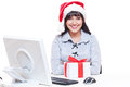 Friendly businesswoman in santa hat Royalty Free Stock Photos