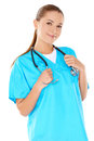 Friendly confident female doctor or nurse with a beautiful smile in green scrubs with a stethoscope around her neck isolated on Royalty Free Stock Photos