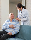 Friendly doctor asks mature man feels Royalty Free Stock Image