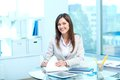 Friendly employer portrait of young female looking at camera while checking proficiency test Royalty Free Stock Photo