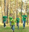 Friendly family running Royalty Free Stock Photo