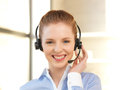 Friendly female helpline operator Royalty Free Stock Images