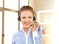 Friendly female helpline operator bright picture of Stock Images