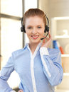 Friendly female helpline operator bright picture of Royalty Free Stock Photography