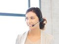 Friendly female helpline operator bright picture of Stock Photos