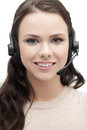 Friendly female helpline operator with headphones Royalty Free Stock Photos