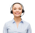 Friendly female helpline operator with headphones business and office concept Stock Photography