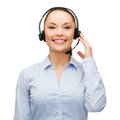 Friendly female helpline operator with headphones business and office concept Royalty Free Stock Images