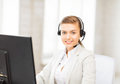 Friendly female helpline operator picture of with headphones Royalty Free Stock Photography