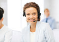 Friendly female helpline operator picture of with headphones Stock Photography