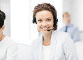Friendly female helpline operator picture of with headphones Royalty Free Stock Image
