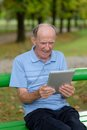 Friendly handsome old man with tablet pc computer Stock Photo