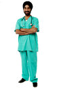 Friendly male doctor full length portrait smiling isolated arms crossed Royalty Free Stock Photography