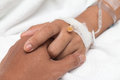 Friendly male hands holding female patient`s hand Royalty Free Stock Photo