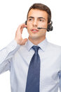 Friendly male helpline operator business and office concept with headphones Royalty Free Stock Image