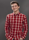 Friendly male student with hands in pockets looking serious Royalty Free Stock Photo