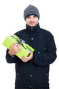 Friendly man with present in winter jacket holding green isolated on white background Stock Photos