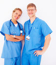 Friendly Nurses standing against white Stock Image