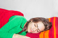 Friendly prank sleeping girl with hand drawn mono eyebrow and moustache on her face Royalty Free Stock Photos