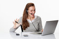 Friendly 20s business executive with headset and computer in white office Royalty Free Stock Photo