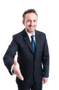 Friendly and smiling business man leaning for hand shake Royalty Free Stock Photo