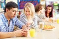 Friendly talk image of teenage couple interacting in cafe Royalty Free Stock Image