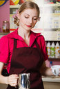 Friendly waitress making coffee Stock Image