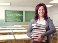 Friendly woman teacher and class background Stock Image