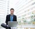 Friendly young man using laptop Royalty Free Stock Photo