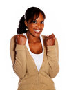 Friendly young woman celebrating a victory Stock Image