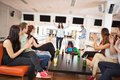 Friends applauding for people bowling group of men and women dancing in club Royalty Free Stock Image
