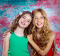 Friends beautiful children girls hug together happy smiling on grunge background Stock Photo