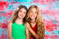 Friends beautiful children girls hug together happy smiling on grunge background Royalty Free Stock Photography