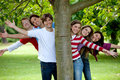 Friends behind a tree Royalty Free Stock Photo