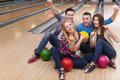 Friends at bowling alley young group of in Stock Image