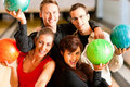 Friends bowling together Royalty Free Stock Image