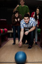 Friends bowling together Stock Image