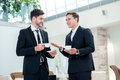 Friends in the business. Two other businessman drinking coffee a Royalty Free Stock Photo