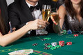 Friends in casino raising a glasses of champagne Royalty Free Stock Images