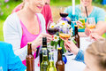 Friends celebrating small garden party clinking glasses Royalty Free Stock Photo