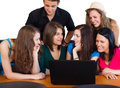 Friends chatting young people together in class talking and laughing Royalty Free Stock Image