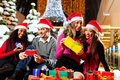 Friends Christmas shopping with presents in mall Royalty Free Stock Photo