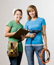 Friends with clipboard, drill and tool belt Royalty Free Stock Photo