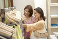 Friends in Clothes Store Royalty Free Stock Photo